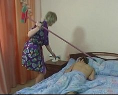 Blonde mama shakes her massive tail feather on top of her son's meat rod