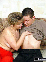 Plump horny lady is fucked by her two sons on the sofa
