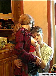 A brunette moter seduces her young son at the kitchen