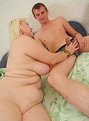 Young lad rams his stone-hard meat down his plump blonde mama's snatch
