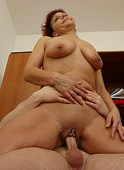 Raunchy full mommy blows her son's sturdy cock and takes it from behind