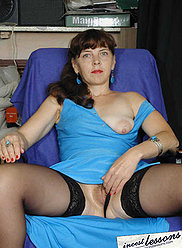 Mature lady poses in blue dress and stockings and then sucks son's shaft