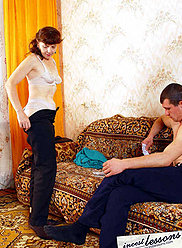 A mother and her young son play undressing cards