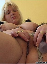 Mature mother caught masturbating with a dildo
