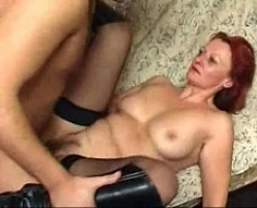 Muscled lover's red-haired aunt bounces on his massive shlong like crazy