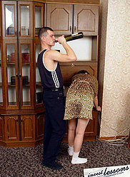 A mature lady is forced to do blowjob by her own young drunkard son
