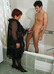 Chubby mom in sexy outfit & nylons sucking son's cock in bathroom