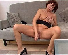 Horny mother is fucking herself with a dildo in front of her son