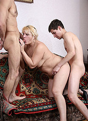 Juicy mom tastes a couple of her sons' dicks