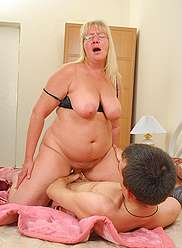 Chubby oldie does her best to seduce and fuck her little hung sonny