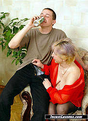 Mother in black stockings does blowjob for her young beer-drinking son