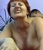 Juicy old redhead gets a real hard doggy-style treatment from her son