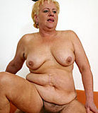 Blonde oldie seduces her grandson by showing him her melons